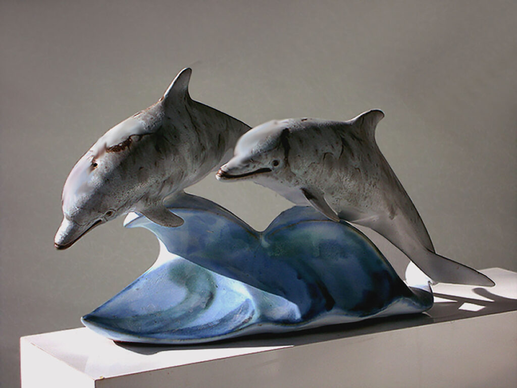 Ceramic Double Dolphins Dancing on a Wave