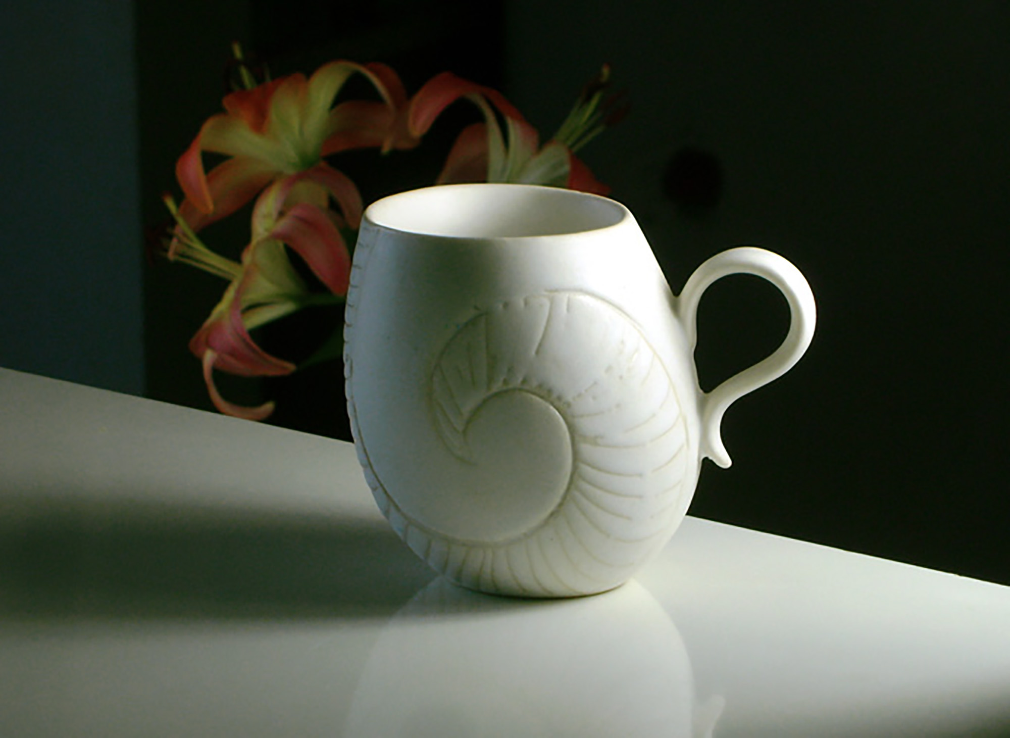 Leaning Mug with Carved Nautilus and small handle